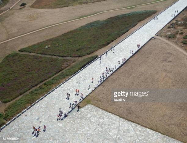 Aerial view of tourists climbing the ramp leading to the Tower of Hercule, symbol of La Coruña.