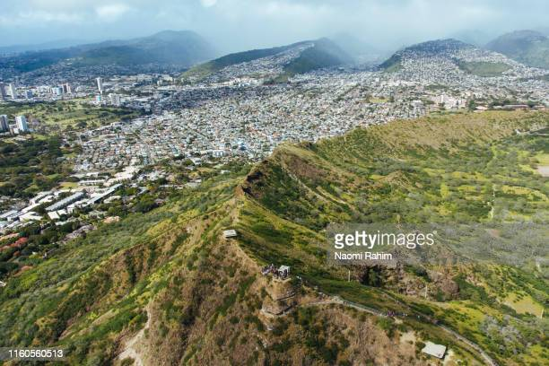aerial view of tourists hiking the diamond head trail peak to the lookout point, honolulu, oahu, hawaii - diamond head stock pictures, royalty-free photos & images