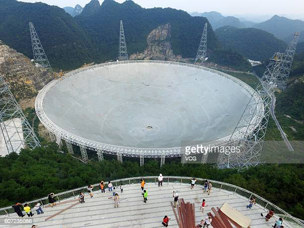 Aerial view of tourists looking at a dishlike radio telescope at Pingtang County on September 17 2016 in Qiannan Buyei and Miao Autonomous Prefecture...
