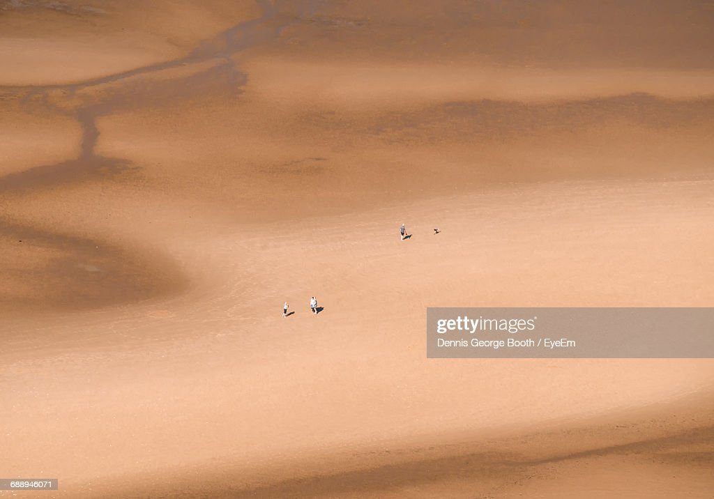Aerial View Of Tourists On Barren Landscape : Stock Photo
