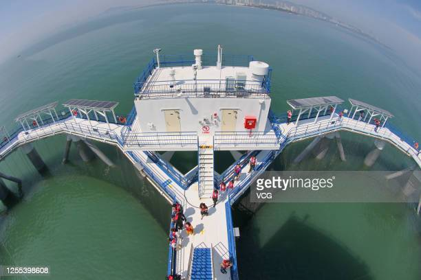 Aerial view of tourists visiting a comprehensive equipment platform for modern marine ranching operated by Shandong Modern Fisheries Corporation in...