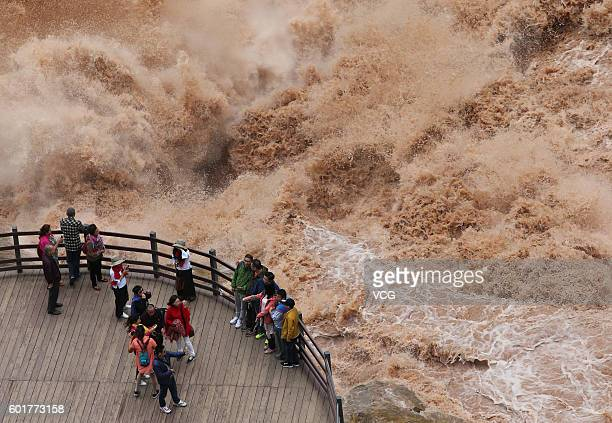 Aerial view of tourists visiting the roaring river at Tiger Leaping Gorge scenic spot on September 9 2016 in Diqing Tibetan Autonomous Prefecture...
