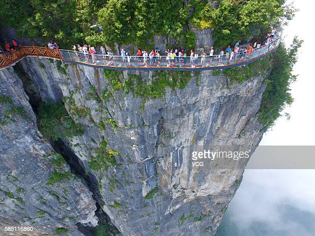 Aerial view of tourists walking on the 100meterlong and 16meterwide glass skywalk clung the cliff of Tianmen Mountain in Zhangjiajie National Forest...
