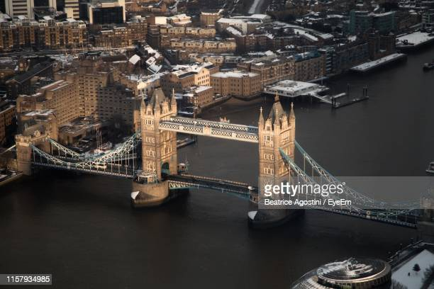 aerial view of tower bridge over thames river in city - beatrice stock pictures, royalty-free photos & images