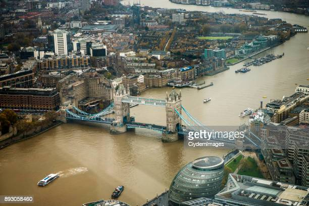 Aerial view of Tower Bridge through The Shard Building's observation point in London City, UK