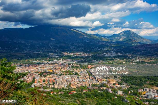 Aerial View Of Town Against Cloudy Sky