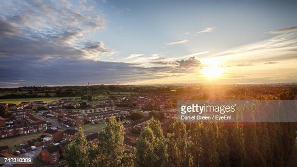aerial view of town against sky at sunset - aylesbury stock photos and pictures