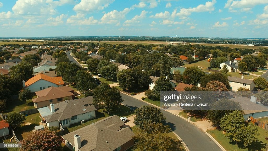 Aerial View Of Town Against Sky : Stock Photo