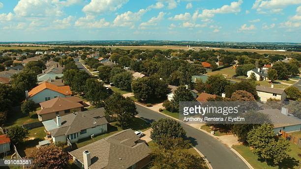 aerial view of town against sky - town stock pictures, royalty-free photos & images