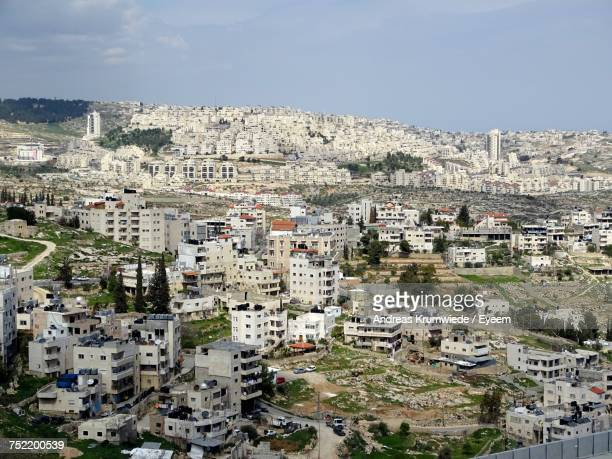 aerial view of town against sky - bethlehem west bank stock pictures, royalty-free photos & images