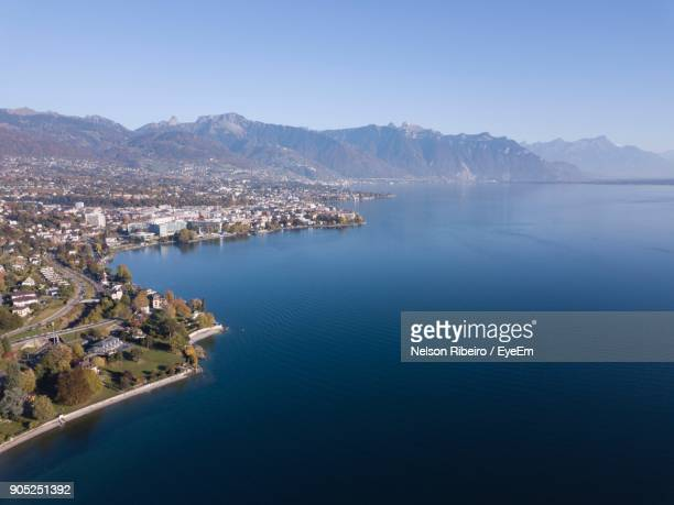 aerial view of town at waterfront - vaud canton stock photos and pictures