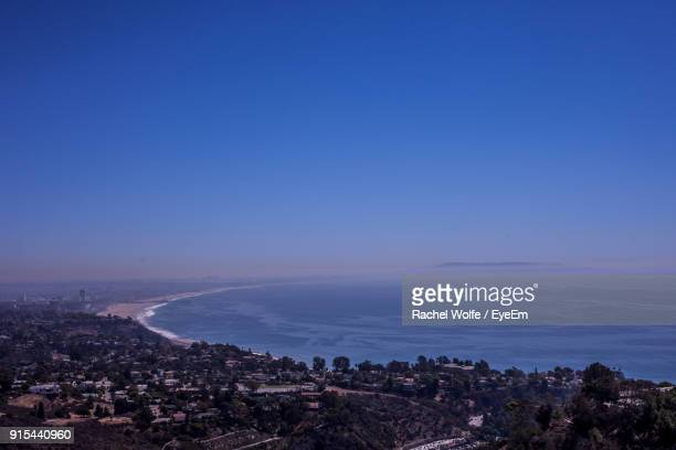 aerial view of town by sea against clear blue sky - rachel wolfe stock pictures, royalty-free photos & images