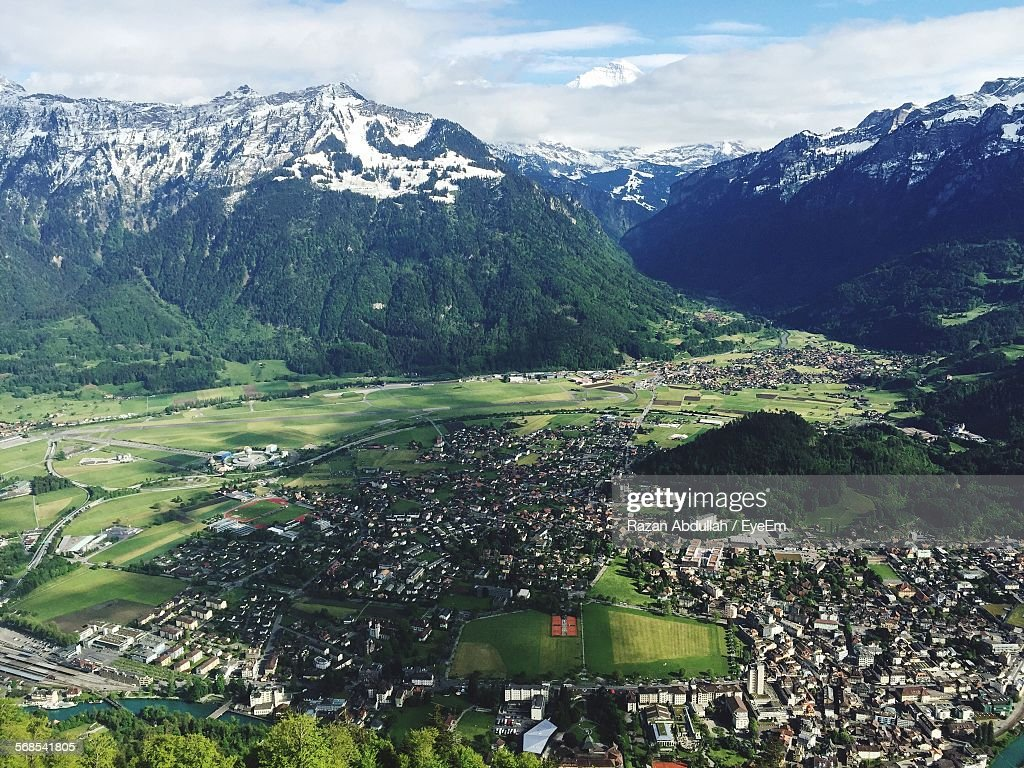 Aerial View Of Town In Front Of Snowcapped Mountains : Stock Photo
