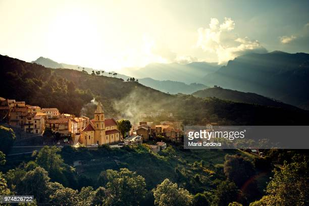 aerial view of town on hillside, corsica, france - corse photos et images de collection
