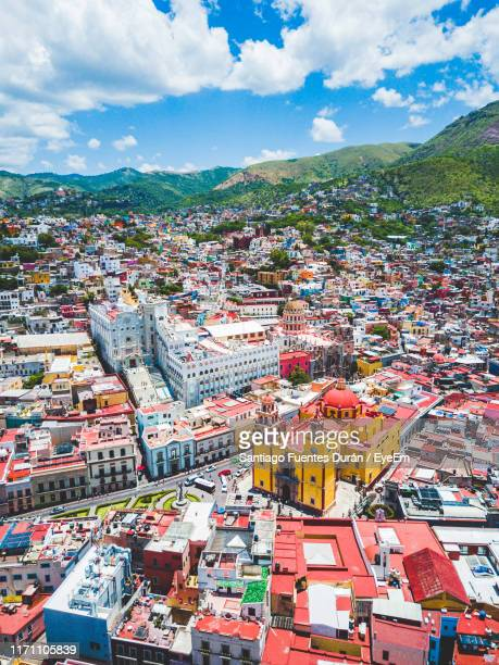 aerial view of townscape against cloudy sky - guanajuato stock pictures, royalty-free photos & images