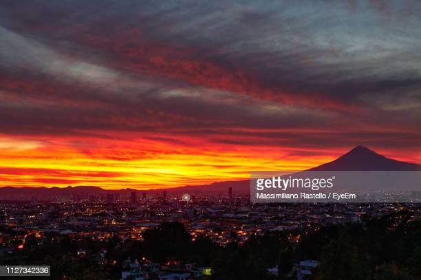 aerial view of townscape against dramatic sky during sunset - puebla state stock pictures, royalty-free photos & images