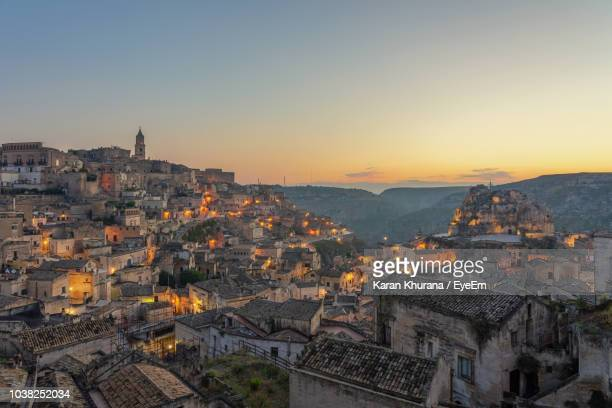 aerial view of townscape against sky during sunrise - matera italy stock pictures, royalty-free photos & images