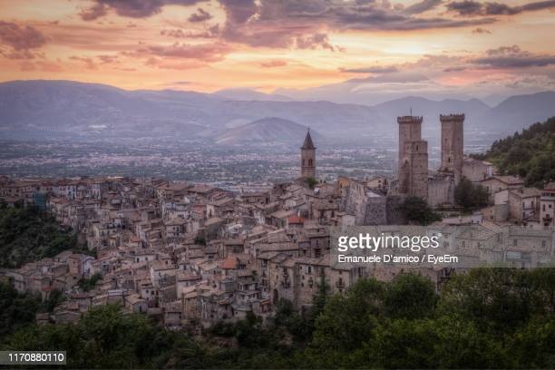 aerial view of townscape against sky during sunset - l'aquila foto e immagini stock