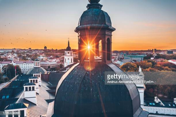 aerial view of townscape against sky during sunset - vilnius stock pictures, royalty-free photos & images