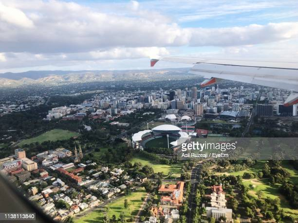 aerial view of townscape against sky - adelaide stock pictures, royalty-free photos & images