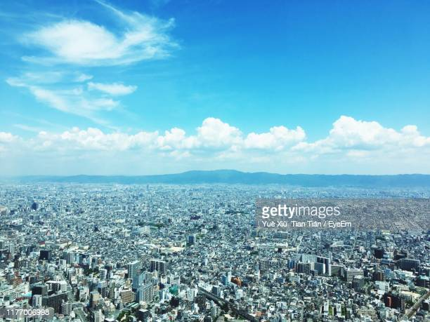 aerial view of townscape against sky - 大阪 ストックフォトと画像