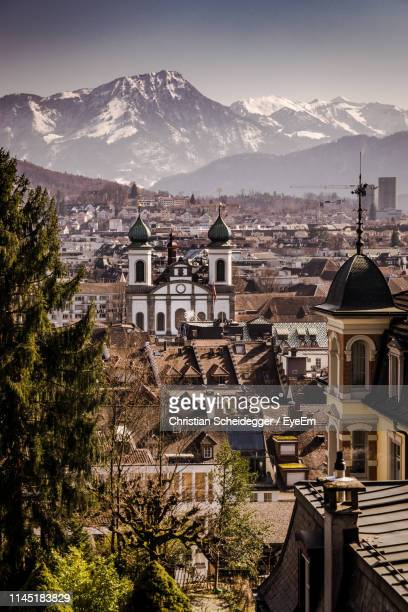 aerial view of townscape and mountains against clear sky - ルツェルン ストックフォトと画像