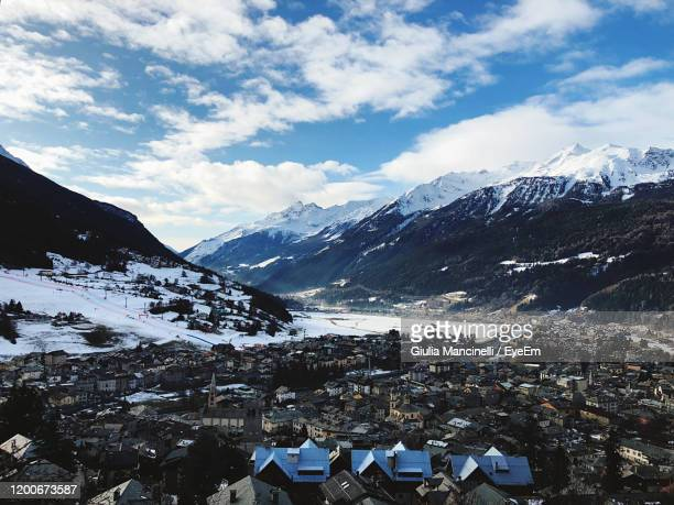aerial view of townscape and mountains against sky - ボルミオ ストックフォトと画像