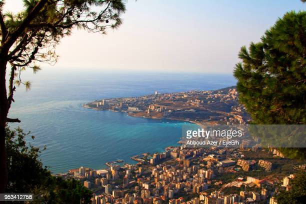 aerial view of townscape by sea against sky - libanon stock-fotos und bilder