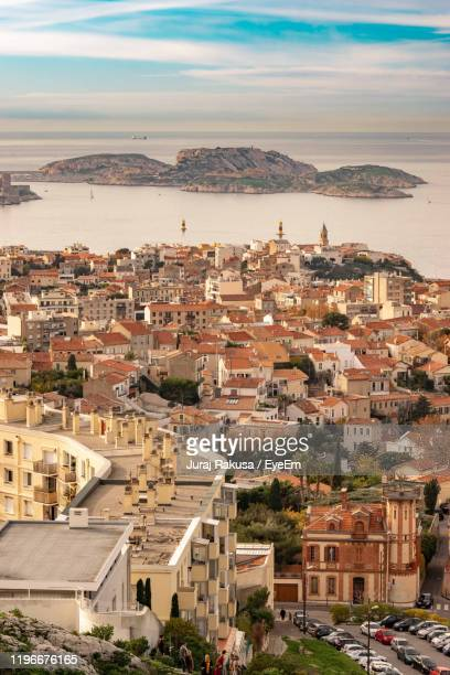 aerial view of townscape by sea - marseille stock pictures, royalty-free photos & images
