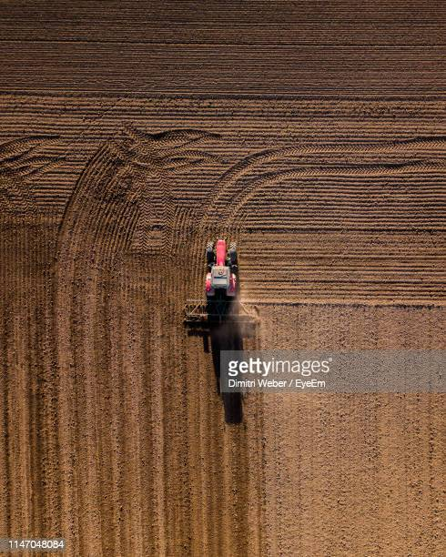 aerial view of tractor on agricultural land - troyes champagne ardenne photos et images de collection