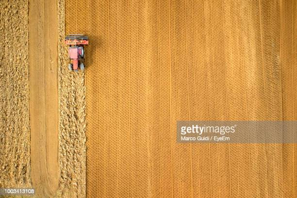 aerial view of tractor on field - farm stock pictures, royalty-free photos & images