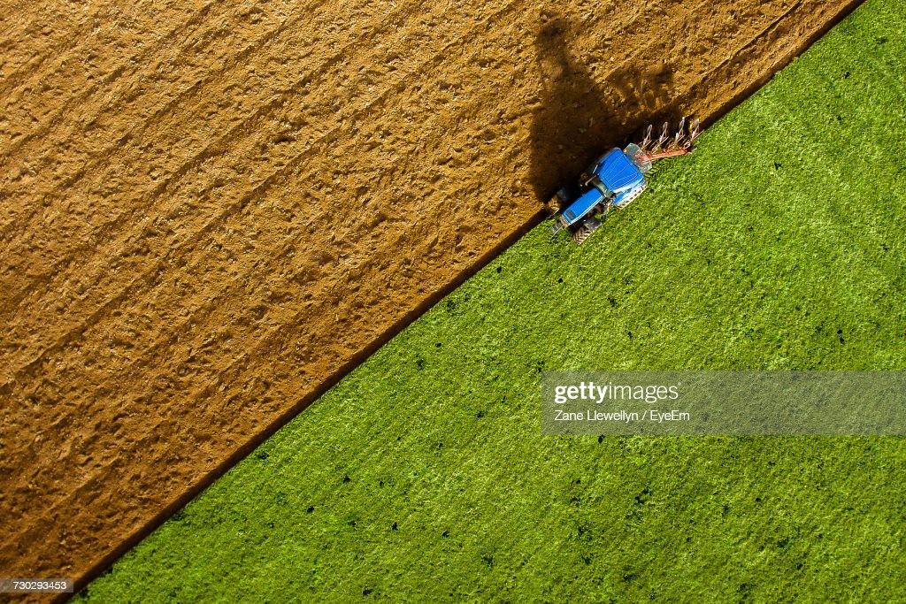 Aerial View Of Tractor Plowing Field : Foto de stock