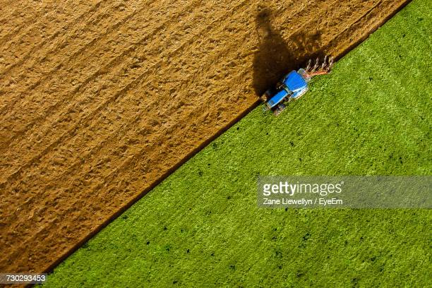 Aerial View Of Tractor Plowing Field