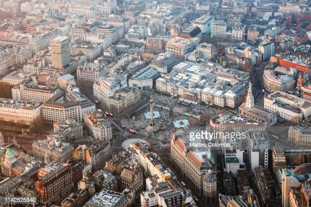 aerial view of trafalgar square at sunset, london, uk - city of westminster london stock pictures, royalty-free photos & images