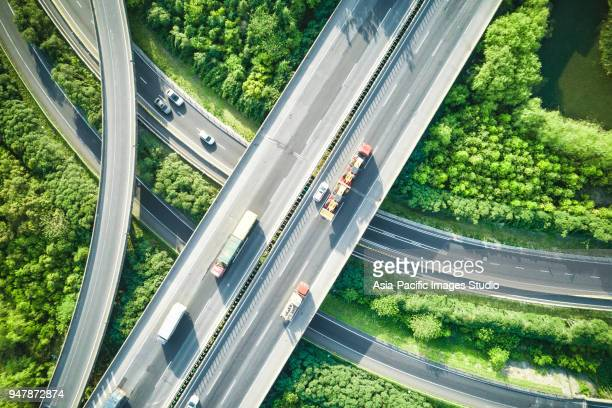 aerial view of traffic and overpasses in spring - flyover stock pictures, royalty-free photos & images