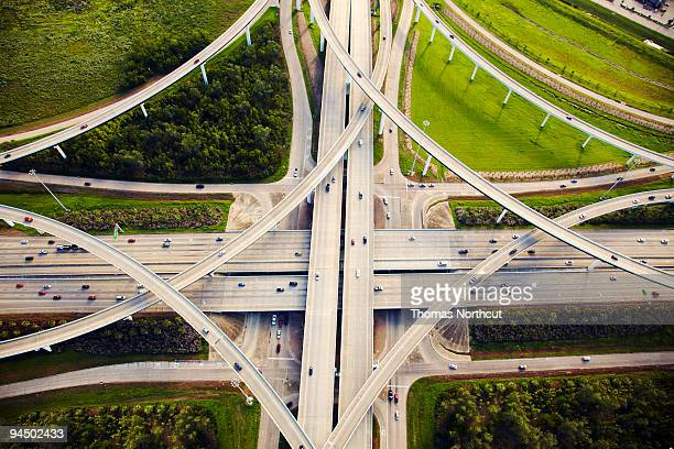 aeirial view of traffic and overpasses - texas stock pictures, royalty-free photos & images