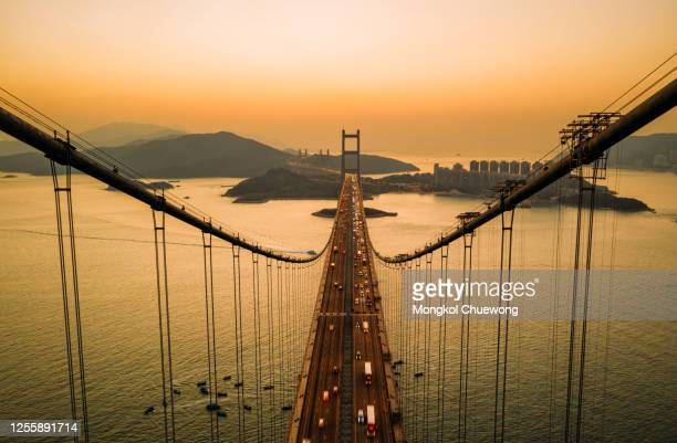 aerial view of traffic of car at tsing ma bridge in tsing yi area of hong kong at sunset. - hong kong stock pictures, royalty-free photos & images