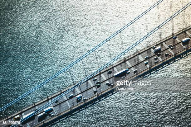aerial view of traffic on george washington bridge in new york - bridge stock pictures, royalty-free photos & images