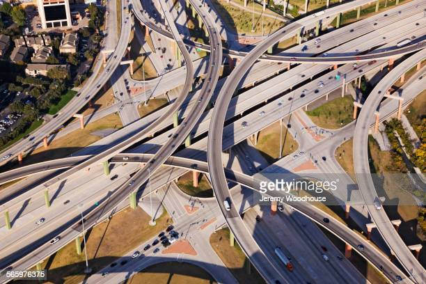 aerial view of traffic on highway interchange roads - dallas stock pictures, royalty-free photos & images