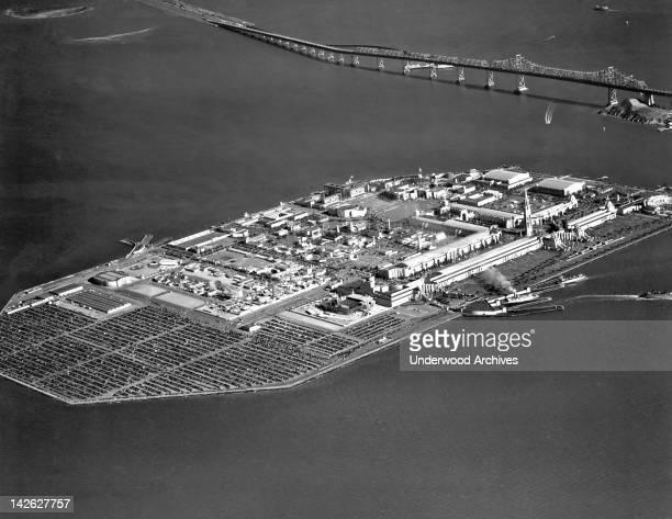 Aerial view of Treasure Island during the Golden Gate International Exposition San Francisco California 1939 The San Francisco Oakland Bay Bridge is...