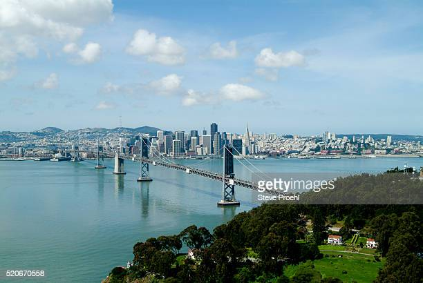 aerial view of treasure island with bay bridge and san francisco, california - treasure island california stock pictures, royalty-free photos & images