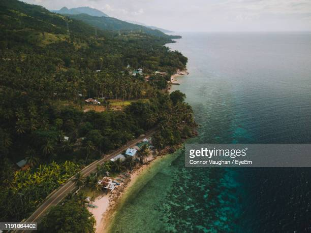 aerial view of trees by sea against sky - cebu province stock pictures, royalty-free photos & images