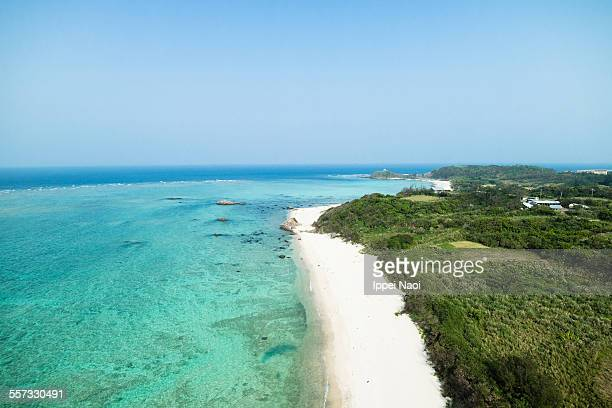 Aerial view of tropical beach and clear blue water