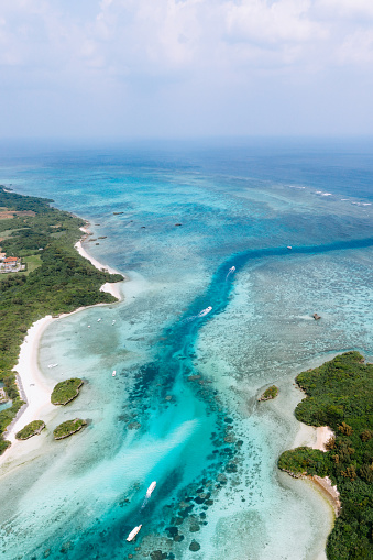 Aerial view of tropical beach and clear water with coral reef, Kabira Bay, Ishigaki Island, Japan - gettyimageskorea