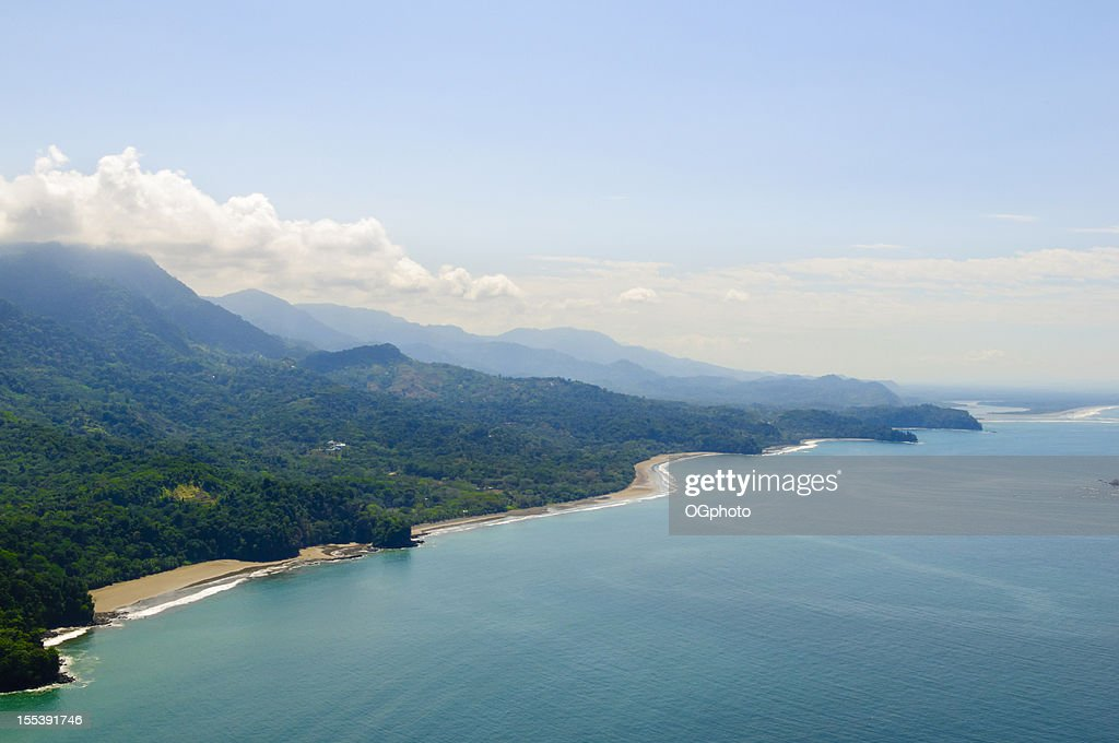Aerial view of tropical forests from mountains to coast. : Stock Photo
