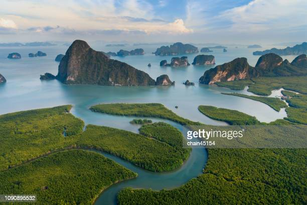 Aerial view of tropical island during sunrise amazing beautiful sea landscape in south of Thailand.