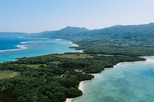 Aerial view of tropical island with coral reef and lagoon, Kabira Bay, Ishigaki Island, Japan - gettyimageskorea