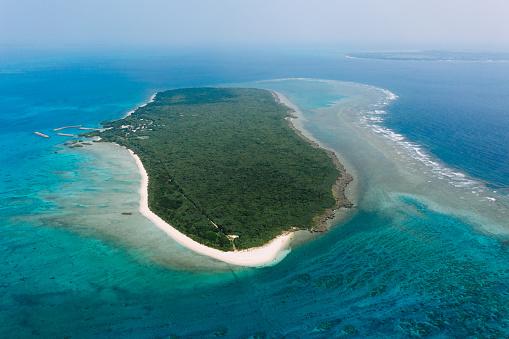 Aerial view of tropical island with coral reef, Aragusuku Islands, Japan - gettyimageskorea