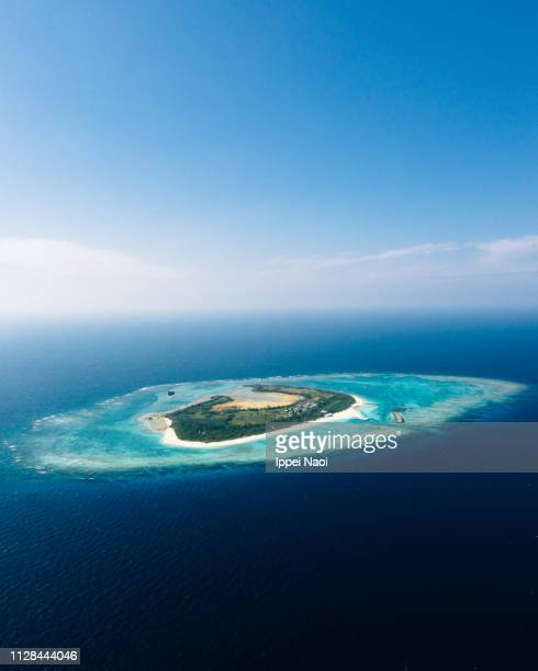 Aerial view of tropical Japanese island with coral reef, Okinawa