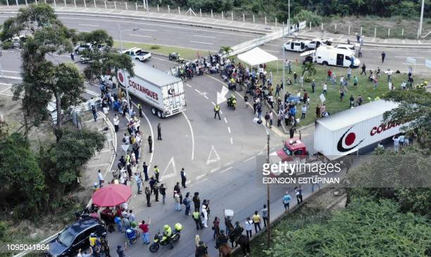 TOPSHOT Aerial view of trucks loaded with humanitarian aid for Venezuela drive to the Tienditas Bridge on the border between Cucuta Colombia and...